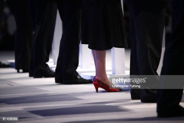 The shoes of Shadow Secretary of State for Work and Pensions Theresa May contrast with other shadow cabinet members on the stage as they address...