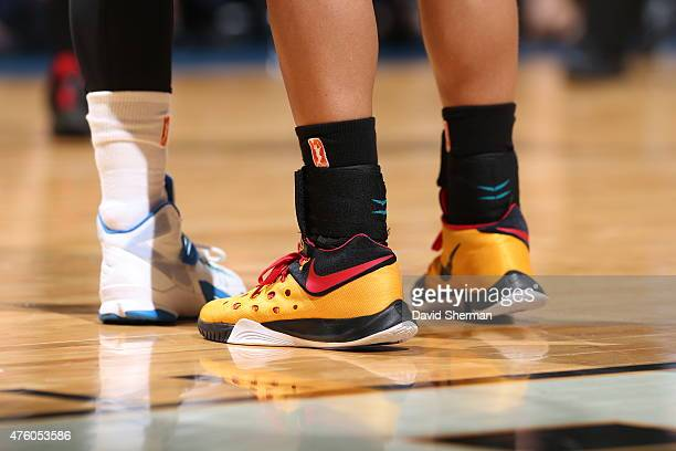 The shoes of Skylar Diggins of the Tulsa Shock are seen against the Minnesota Lynx during the season opener of their WNBA game on June 5 2015 at...