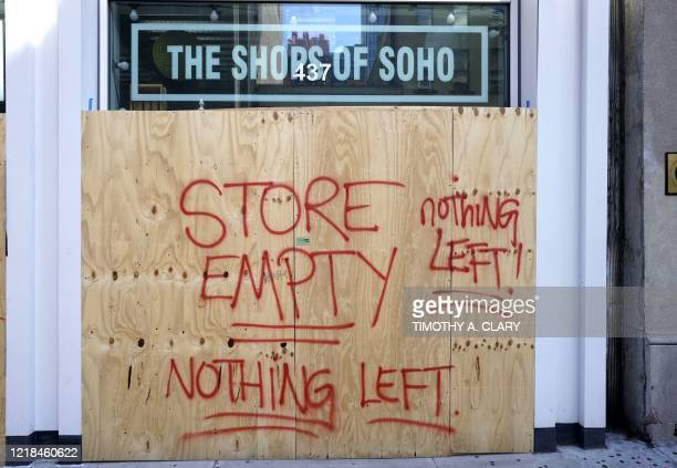The Shoes of Soho store is seen boarded up on June 8 2020 after rampant open looting and vandalism in New York following the Minneapolis police...