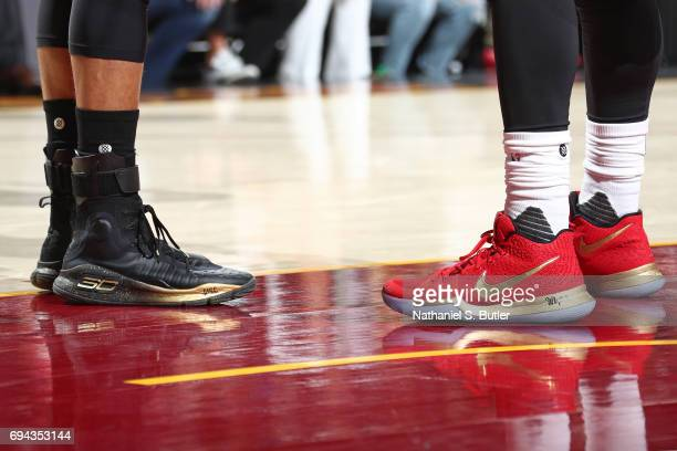 The shoes of Stephen Curry of the Golden State Warriors and Kyrie Irving of the Cleveland Cavaliers in Game Four of the 2017 NBA Finals on June 9...