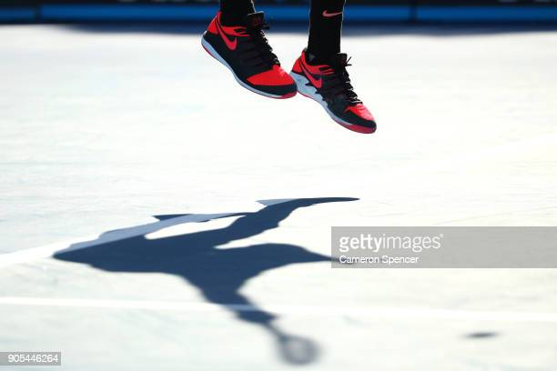 The shoes of Thanasi Kokkinakis of Australia are seen in his first round match against Daniil Medvedev of Russia on day two of the 2018 Australian...