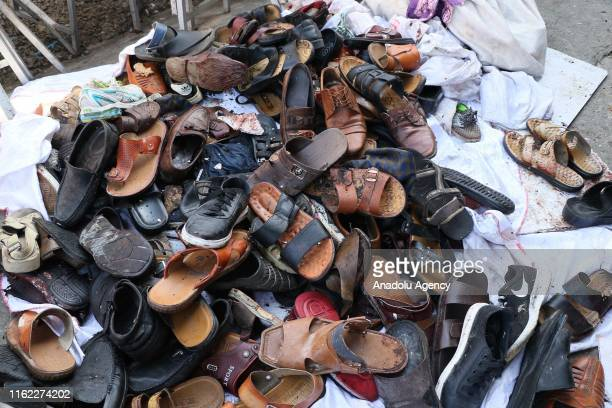 The shoes of the victims of the suicide bomb attack lay at the wedding hall after an overnight suicide bomb blast that targeted a wedding reception...