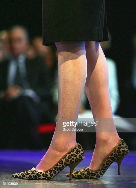 The shoes of Theresa May Shadow Secretary of State for the Family from Britain's Conservative Party are seen as she delivers her speech during day...
