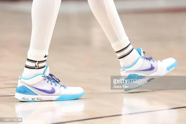 The shoes worn by Anfernee Simons of the Portland Trail Blazers honoring the passing of former NBA legend Kobe Bryant and his daughter Gianna during...