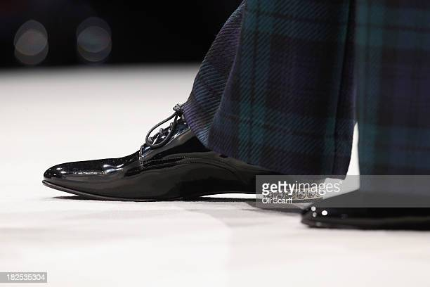 The shoes worn by Home Secretary Theresa May as she delivers her speech in the main hall on the second day of the Conservative Party Conference on...