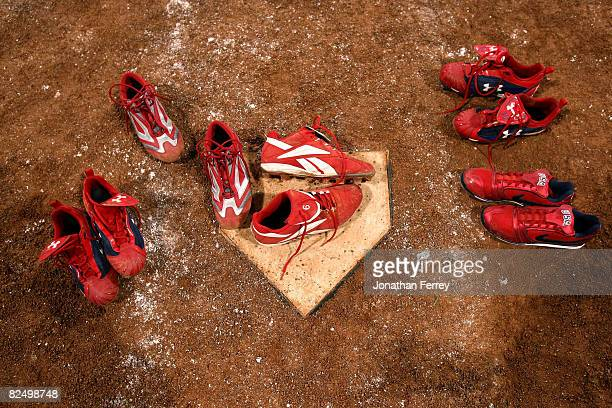 The shoes worn by players from the United States remain at home plate after the five players left them there following USA's 31 loss to Japan during...