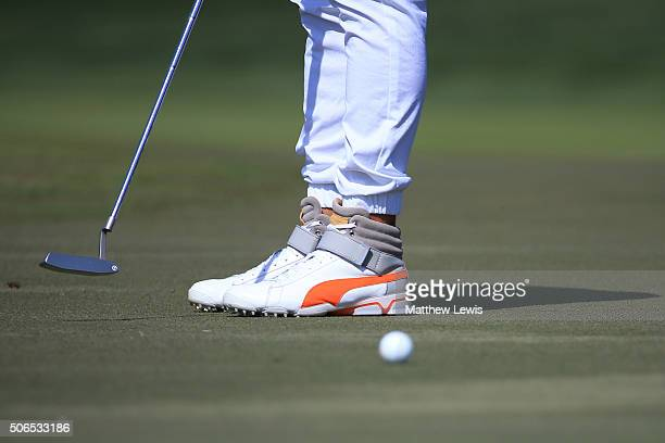 The shoes worn by Rickie Fowler of the United States are pictured as he putts during round four of the Abu Dhabi HSBC Golf Championship at the Abu...