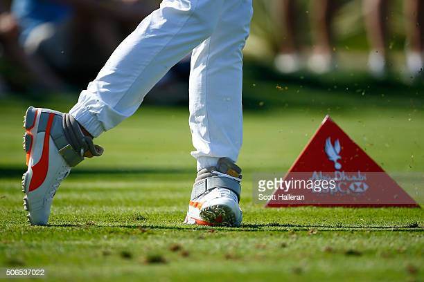 The shoes worn by Rickie Fowler of the United States are pictured as he tees off on the 7th hole during round four of the Abu Dhabi HSBC Golf...