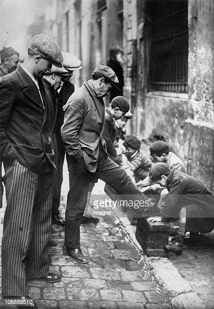 The shoeshine boys of Marseille polish the shoes of their clients in the gutters while their clients already queue up France Photograph Around 1930