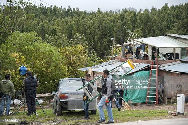 The shooting crew works next to a house used as a location during the filming of the movie Blunt Force Trauma on October 8 near Choachi Cundinamarca...