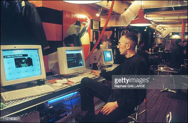 """The """"Shop"""", internet cafe: an internet user sits in front of a computer in Paris, France in December, 1995."""