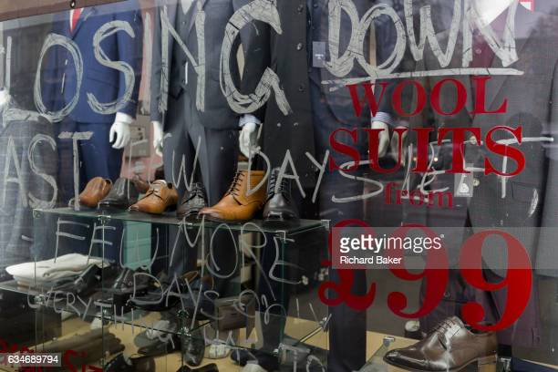 The shop window of a menswear and shoe retailer with big reductions and deals but closing down soon on 2nd February 2017 in the City of London England