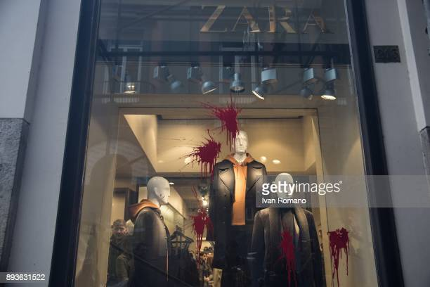 The shop windows of Zara a company that took part in the alternating schoolwork plan stained with red paint during a demonstration in the streets of...