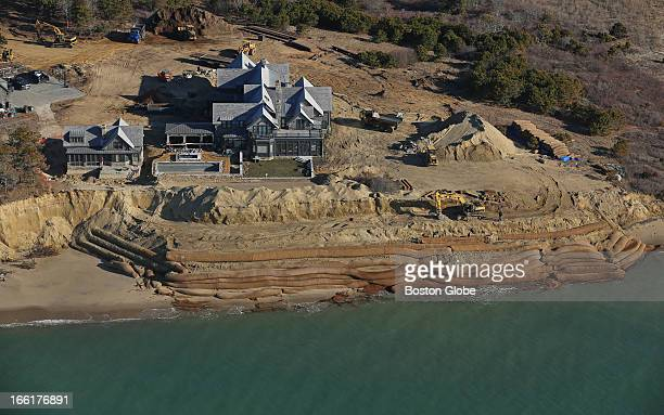 The shoreline is eroding on Chappaquiddick Island near Wasque Point Water laps against the barriers piled in front of the Schifter property