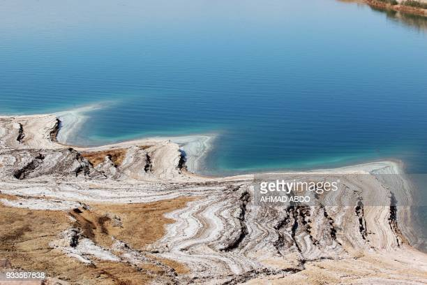 The shoreline of the Dead Sea is seen near the village of alHaditha in Jordan on March 11 2018 Israel and Jordan have long pursued a common goal to...