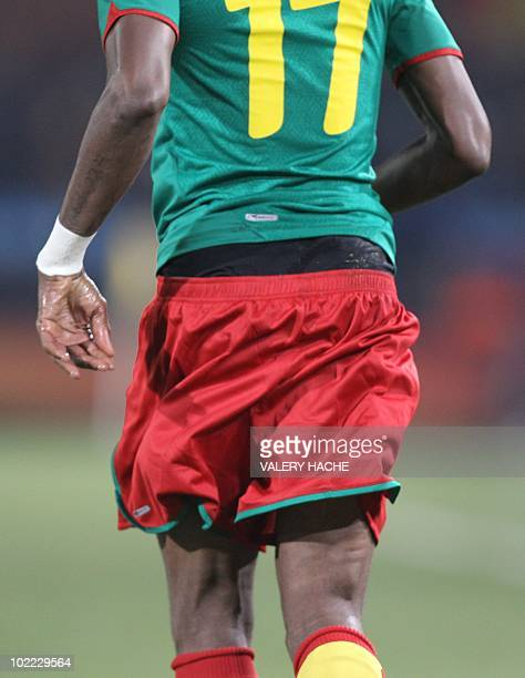 The shorts of Cameroon's striker Mohamadou Idrissou ride low during their Group E first round 2010 World Cup football match on June 19 2010 at Loftus...