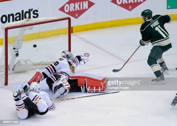 The shot by Mikael Granlund of the Minnesota Wild gets past Brent Seabrook and Corey Crawford of the Chicago Blackhawks as Zach Parise of the...