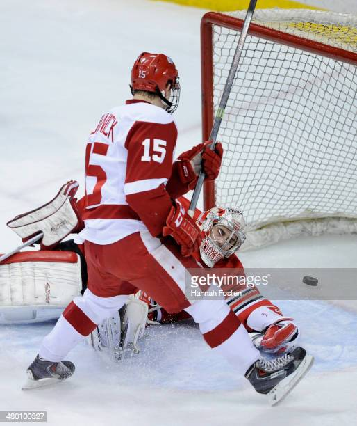 The shot by Morgan Zulinick of the Wisconsin Badgers gets past Christian Frey of the Ohio State Buckeyes during the second period of the Big Ten...