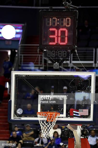 The shot clock is shown on after technical difficulties as the Syracuse Orange play the Pittsburgh Panthers during the first half in the second round...