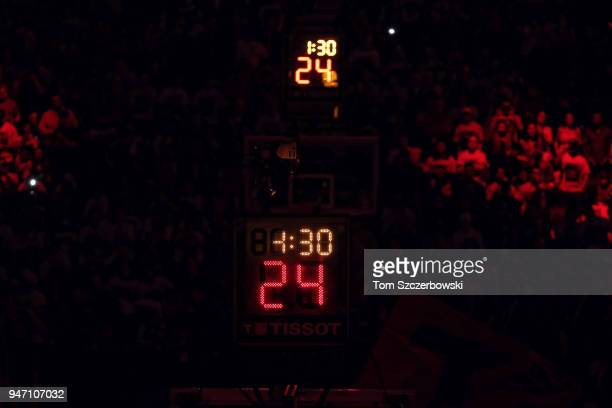 The shot clock on both ends of the court as the lights are turned down during pregame introductions before the start of the Toronto Raptors game...