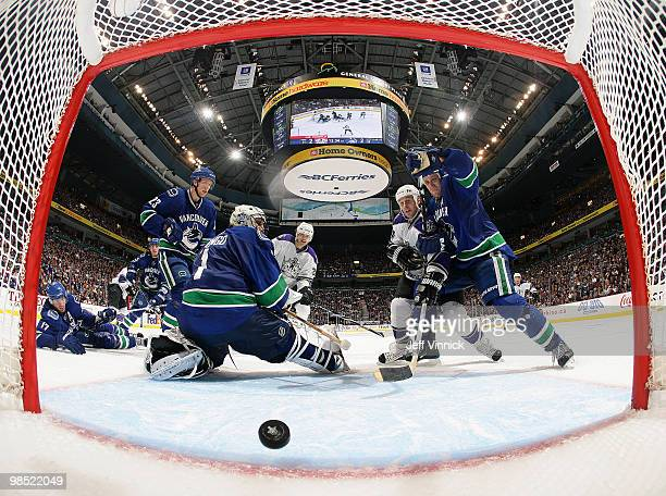 The shot of Anze Kopitar of the Los Angeles Kings gets by Roberto Luongo of the Vancouver Canucks for the overtime winning goal as Sami Salo and...