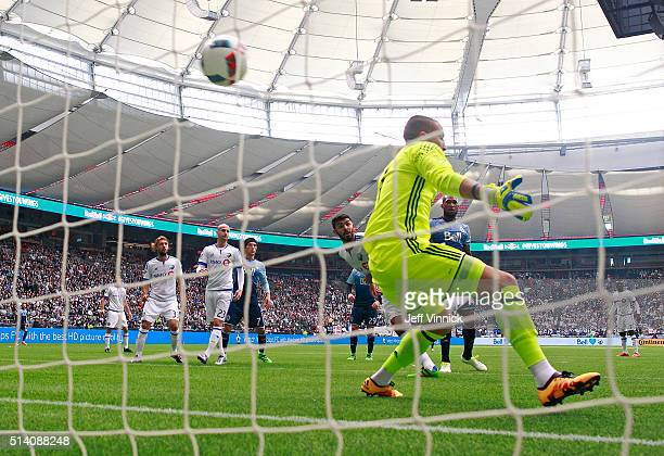 The shot of Jordan Harvey of the Vancouver Whitecaps gets past Evan Bush of the Montreal Impact for a Vancouver goal during their MLS game March 6...