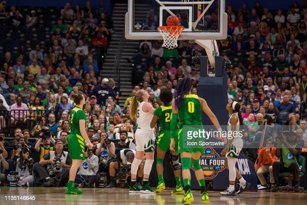 The shot of Oregon guard Morgan Yaeger gets stuck on the rim before falling through the net in 2019 NCAA Women's Division I Championship Final Four...