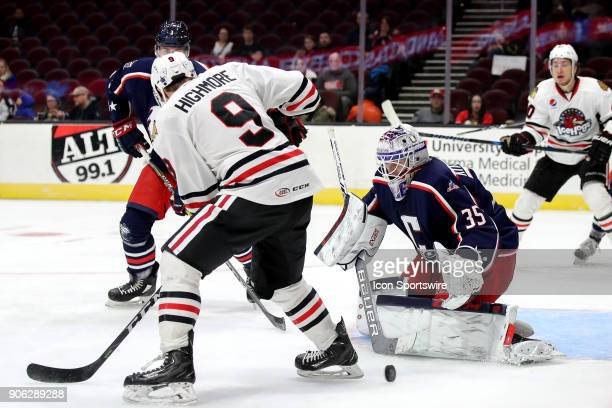 The shot of Rockford IceHogs left wing Matthew Highmore deflects off the pads of Cleveland Monsters goalie Matiss Kivlenieks during the third period...
