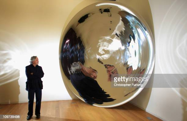Artist Anish Kapoor stands next to a detail from his work 'Her Blood' part of his exhibition Flashback at Manchester Art Gallery on March 3 2011 in...