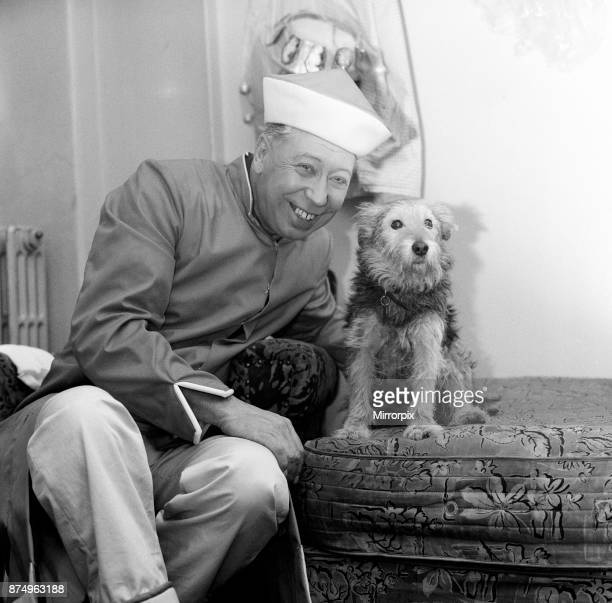 The show must go on says George Formby appearing as Mr Wu in 'Aladdin' at the Hippodrome Bristol George who lost his wife at the weekend relaxes with...