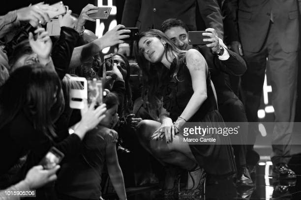 The showgirl Belen Rodriguez taking a selfie with her fans after a show in Naples