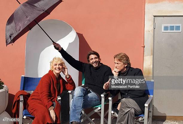 The showgirl Loretta Goggi and the actors Daniele Liotti and Cesare Bocci relaxing on the set of the TV miniseries Un'altra vita Ponza Island Italy...