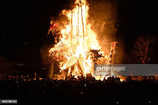 The shrine and a family totem pole are burned during the Nozawaonsen Dosojin Fire Festival on January 15 2018 in Nozawaonsen Japan The festival is...