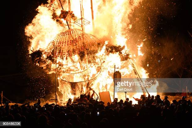 NOZAWAONSEN JAPAN JANUARY The shrine and a family totem pole are burned during the Nozawaonsen Dosojin Fire Festival on January 15 2018 in...