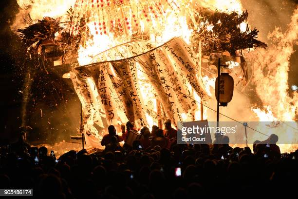 The shrine and a family totem pole burn during the Nozawaonsen Dosojin Fire Festival on January 15 2018 in Nozawaonsen Japan The festival is staged...