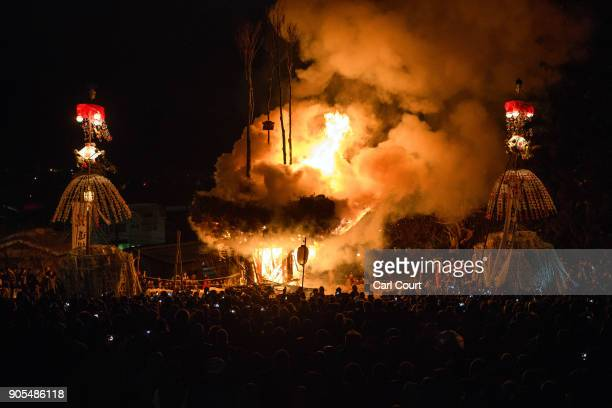 The shrine burns during the Nozawaonsen Dosojin Fire Festival on January 15 2018 in Nozawaonsen Japan The festival is staged by village men of...
