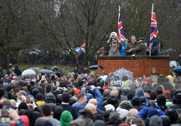 The Shrovetide Ball is held aloft at the start of the match as Rival teams 'Up'ards' and 'Down'ards' battle for the best position to receive it...