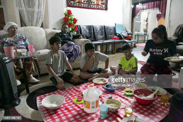 The Shukor family eats dinner on January 12 2019 in Chicago Illinois The Shukor family arrived in Chicago in 2014 from Malaysia Mohammad Shukor fled...
