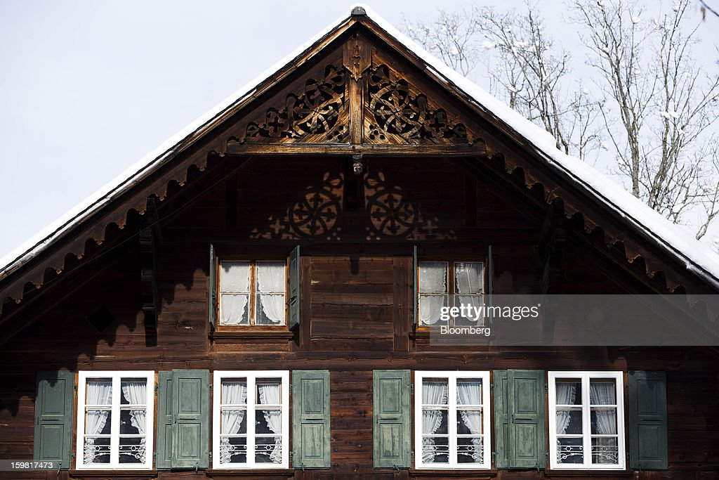 The shuttered windows and pitched roof of a traditional wooden Swiss chalet are seen in Gstaad, Switzerland, on Saturday, Jan. 19, 2013. Options traders are pushing the cost of bearish wagers on Swiss shares to the lowest level in almost seven years amid optimism a decline in the franc versus the euro will benefit the nation's exporters. Photographer: Valentin Flauraud/Bloomberg via Getty Images
