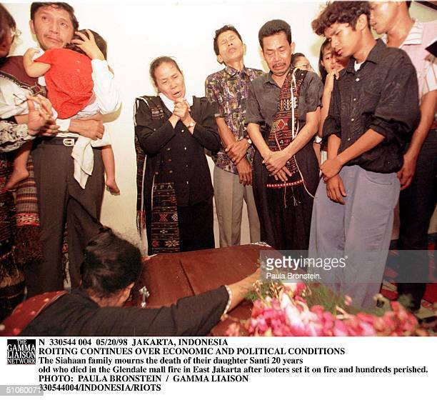 The Siahaan Family Mourns The Death Of Their Daughter Santi 20 Years Old Who Died In The Glendale Mall Fire In East Jakarta After Looters Set It On...