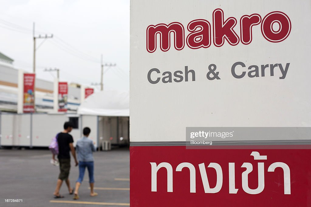 The Siam Makro Pcl logo is displayed on a sign outside one of the company's Makro stores in Bangkok, Thailand, on Tuesday, April 23, 2013. Billionaire Dhanin Chearavanont's CP All Pcl, Thailand's 7-Eleven chain, offered to pay about $6.6 billion for discount retailer Siam Makro Pcl in the biggest takeover announced in Asia this year. Photographer: Brent Lewin/Bloomberg via Getty Images