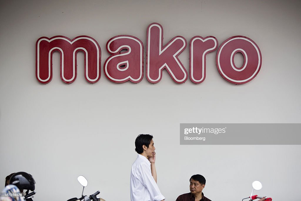 The Siam Makro Pcl logo is displayed outside one of the company's Makro stores in Bangkok, Thailand, on Tuesday, April 23, 2013. Billionaire Dhanin Chearavanont's CP All Pcl, Thailand's 7-Eleven chain, offered to pay about $6.6 billion for discount retailer Siam Makro Pcl in the biggest takeover announced in Asia this year. Photographer: Brent Lewin/Bloomberg via Getty Images