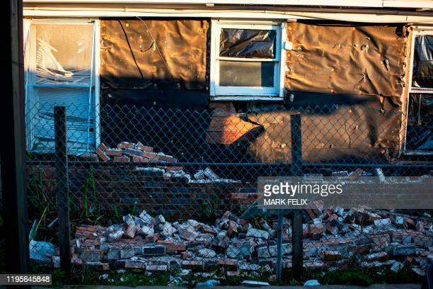 The side brick facade of a building collapsed after an explosion at a northwest Houston Texas manufacturing business on January 24 2020 A large...