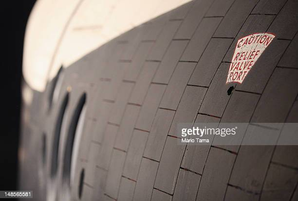 The side of the Space Shuttle Enterprise is seen at a press preview of the Intrepid Sea Air Space Museum's new Space Shuttle Pavilion on July 18 2012...