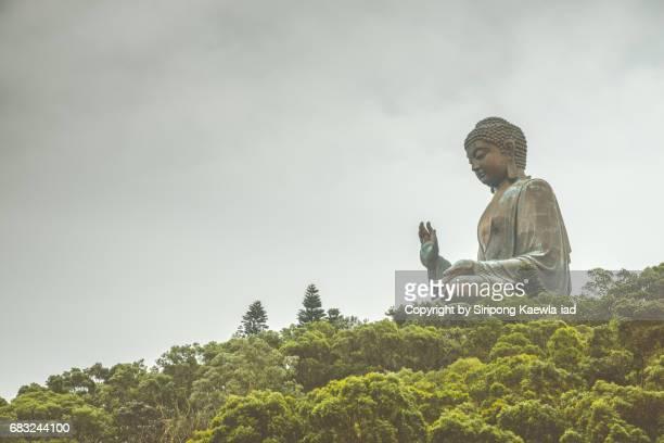 The side view of the giant Tian Tan Buddha image (Big Buddha) statue in Ngong Ping, Lantau island, Hong Kong.