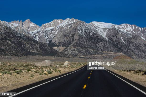 The Sierra Nevada Mountains are viewed from Whitney Portal Road after sunrise on April 6 near Lone Pine California Owens Valley is an arid valley in...