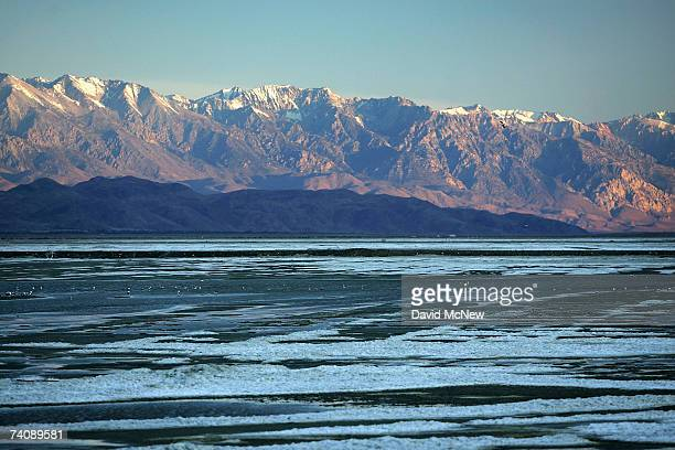 The Sierra Nevada Mountains rise to more than 14000 feet in elevation behind Owens Lake fed by the snows of the Sierras which are currently lower...
