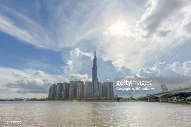 sai gon, vietnam - september 22, 2018: the sight of the tower landmark 81 with sparkling lights reflecting the sai gon river. it is one of the tallest buildings in the world - people's committee building ho chi minh city stock pictures, royalty-free photos & images