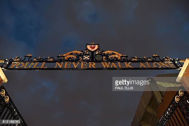 The sign above the relocated Shankly Gates is seen illuminated ahead of the English Premier League football match between Liverpool and Manchester...