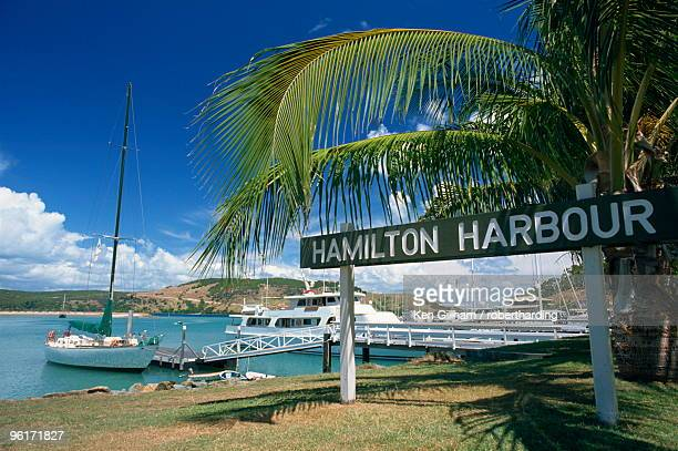 The sign and boats at Hamilton Harbour on Hamilton Island, Great Barrier Reef, Queensland, Australia